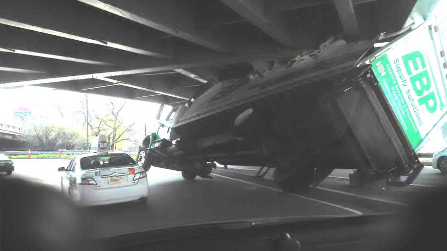 The top of the tractor-trailer was sheared off after hitting the overpass.
