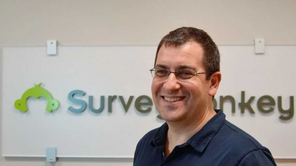 David Goldberg, CEO of online market researcher SurveyMonkey, in front of the company logo at headquarters in Palo Alto, Calif. Goldberg died unexpectedly Friday in Mexico.