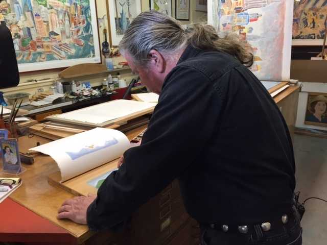 Bill Evaul, block print artist, at work in Provincetown.