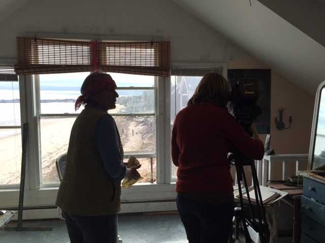 Videographer Judi Guild shoots the work of accomplished artist Anne Packard.