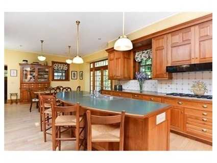 Spacious gourmet kitchen w/dining area, island & butler's pantry is an entertainer's dream.
