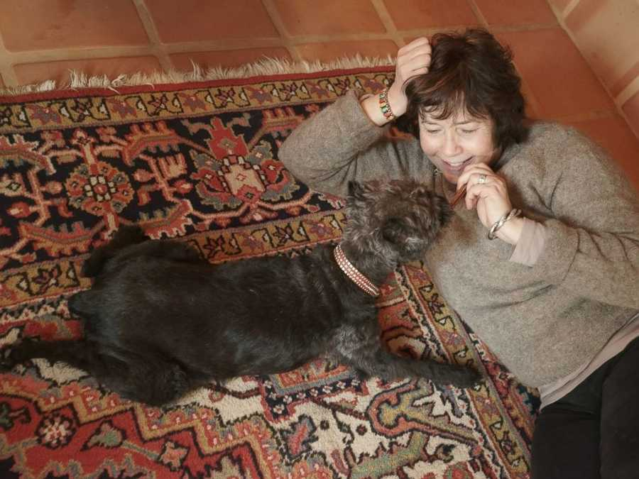 """Donations are greatly appreciated, but I offer this service to everyone, regardless of their ability to pay.Owner Carol is photographed with her dog, """"Harry."""""""