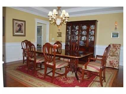 Dining room with tray ceiling.