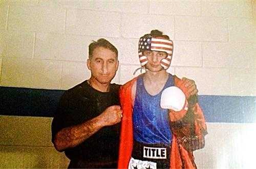 Clarke shows jury a photo of Dzhokhar Tsarnaev's father Anzor at a boxing ring with Tamerlan.