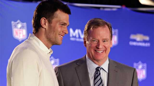 In this Feb. 2, 2015, file photo, New England Patriots quarterback Tom Brady, left, poses with NFL Commissioner Rodger Goodell during a news conference where Goodell presented Brady with the MVP award from the NFL Super Bowl XLIX football game.