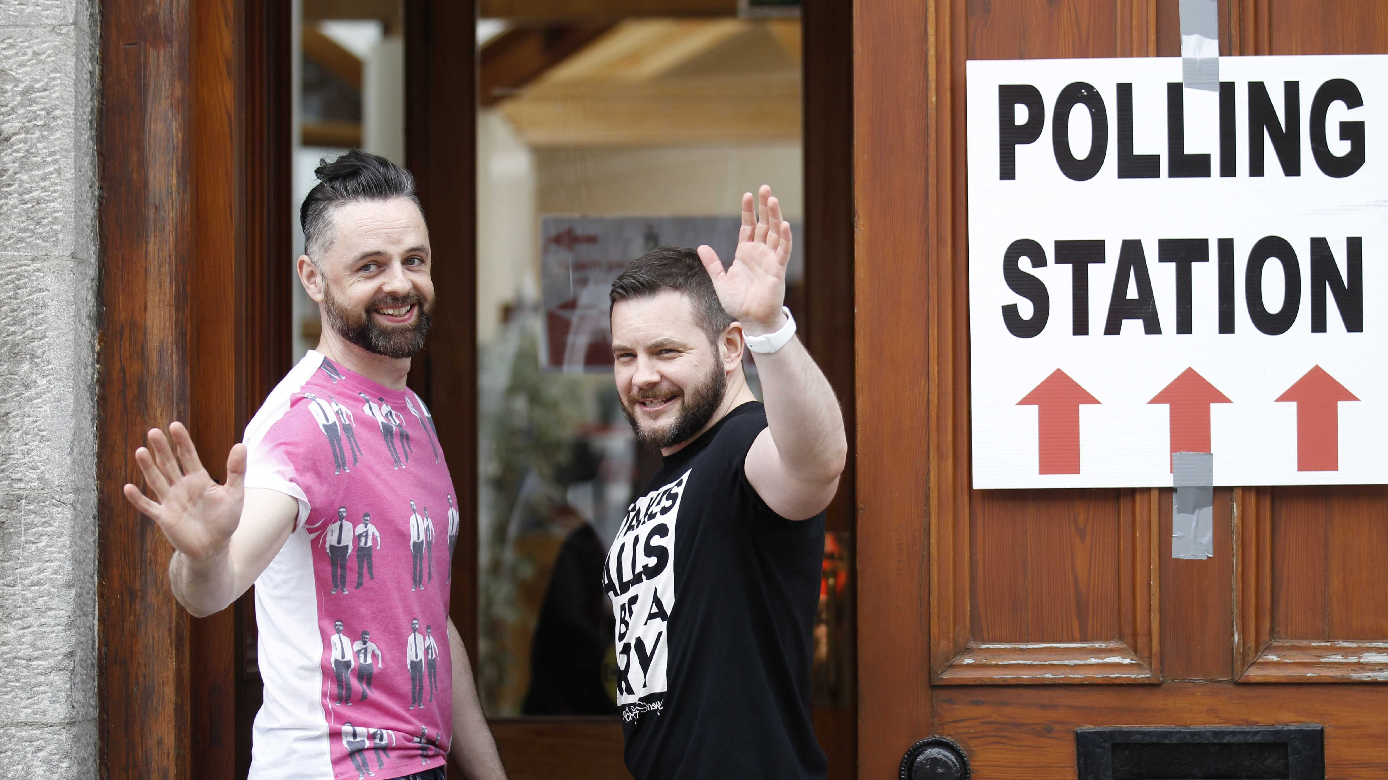 Partners Adrian, left and Shane, arrive to vote at a polling station in Drogheda, Ireland, Friday, May 22, 2015. Ireland began voting Friday in a referendum on Gay marriage.