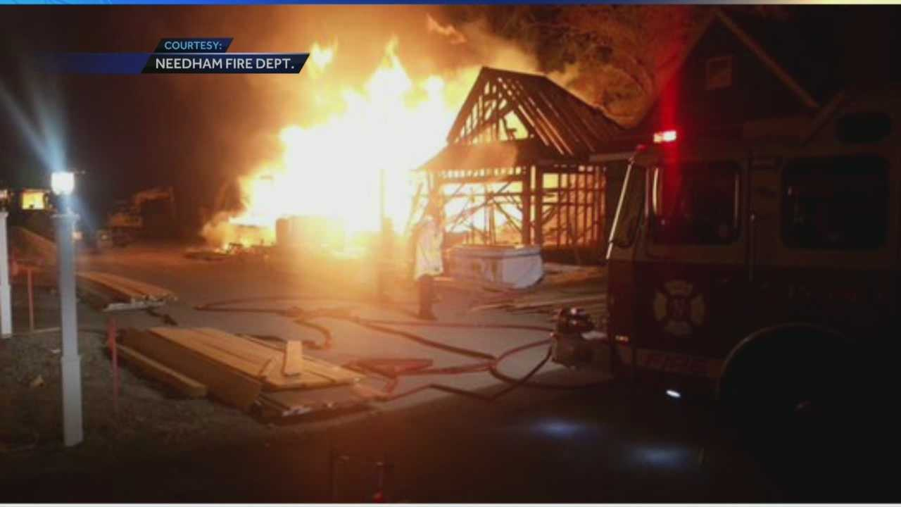 A three-alarm fire swept through a condo complex in Needham Saturday morning.