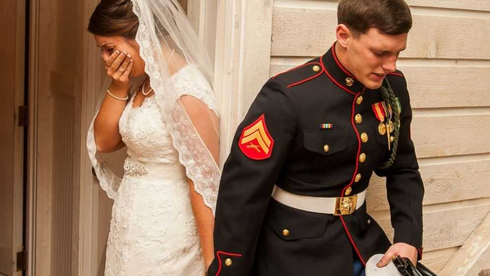 U.S. Marine Cpl. Caleb Earwood prays with his bride-to-be Maggie before their wedding service on Saturday in Asheville, North Carolina.