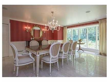 This private special property located in The Weston Estate neighborhood on a cul-de-sac offers many bells & whistles including an elevator - gracious entry way, spacious living room with fireplace, sunny kitchen with fireplace