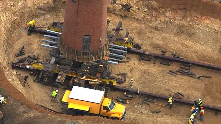 Crews already have hoisted the 400-ton brick-and-mortar lighthouse about six feet off the ground and placed it on a wood-and-steel frame ready for the move.