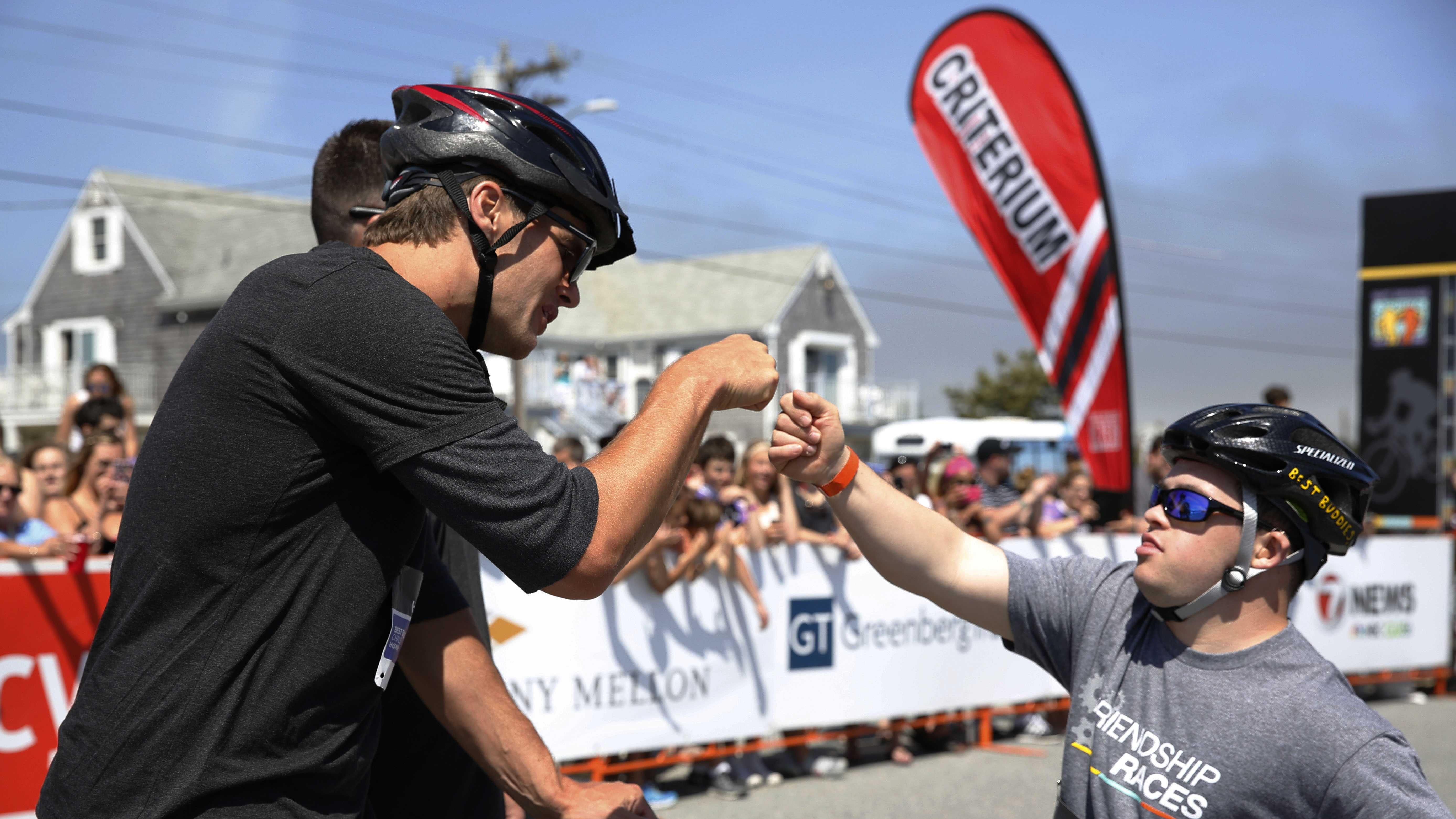 Tom Brady and his race partner, Chris Harrington, 24, prepare to compete in the Best Buddies Friendship Races at Craigville Beach in Centerville, Mass. on Saturday, May 30, 2015. The races were held as part of The 16th Annual Best Buddies Challenge event.
