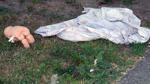 A doll and comforter lie on the ground in front of 4 Highland Court, where police say a young boy who was hit by a car Friday night had been living.