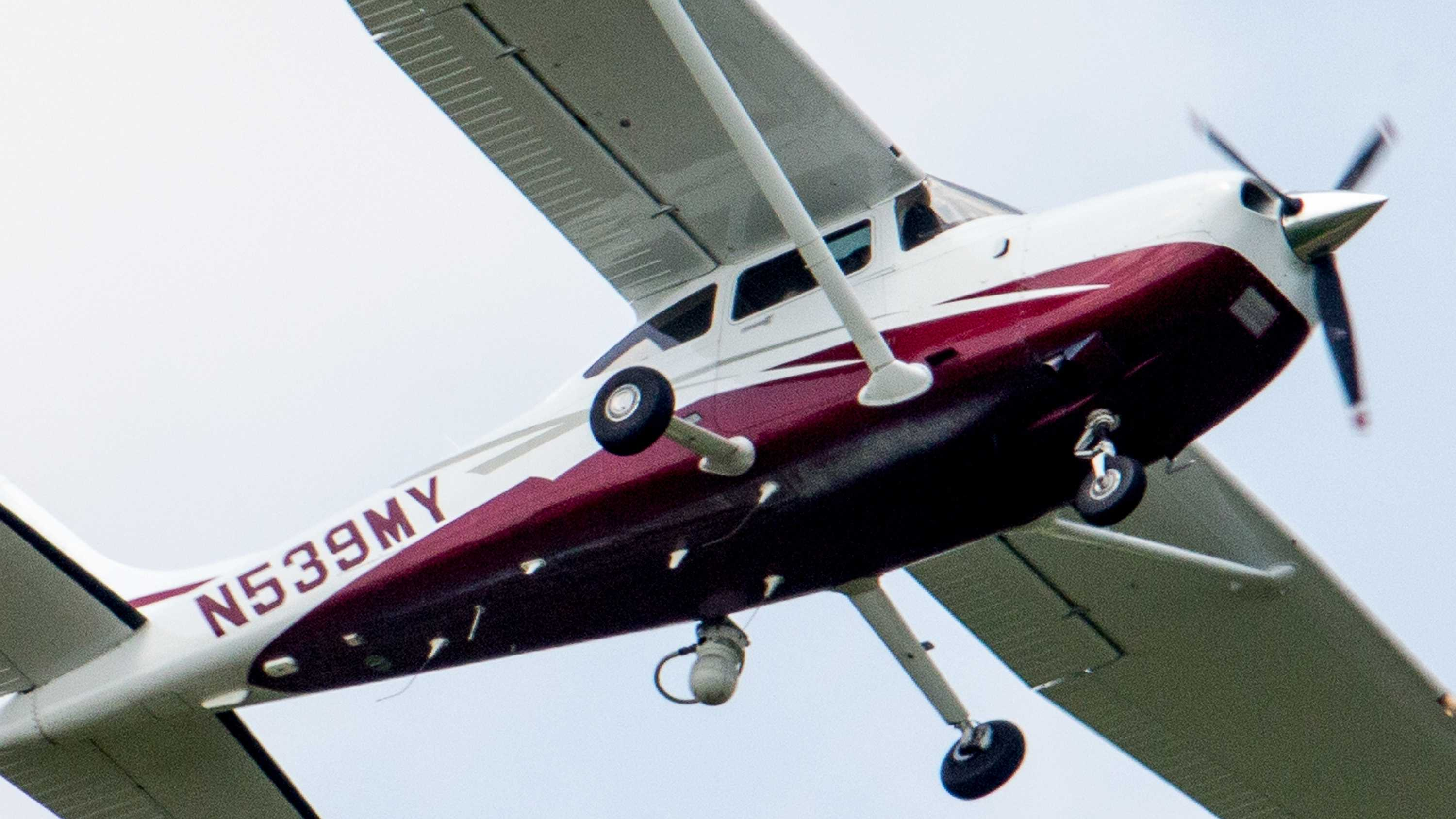 In this photo taken May 26, 2015, a small plane flies near Manassas Regional Airport in Manassas, Va. The plane is among a fleet of surveillance aircraft by the FBI, which are primarily used to target suspects under federal investigation. Such planes are capable of taking video of the ground, and some _ in rare occasions _ can sweep up certain identifying cellphone data.