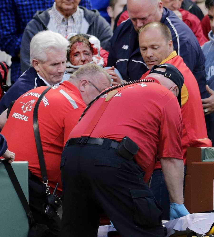 A woman suffers life-threatening injuries after being hit by a broken bat during the Red Sox game against the Oakland Athletics at Fenway Park on Friday night.