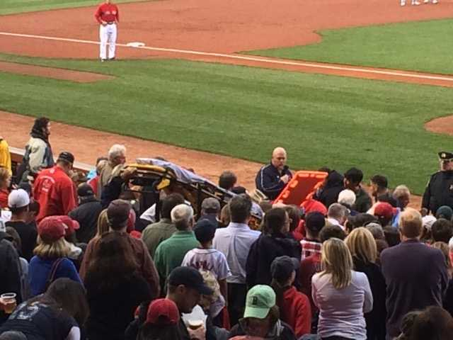 After the third out, the game was delayed while the fan was tended to in the stands between home plate and the third base dugout. She was wheeled off on the stretcher for further treatment.