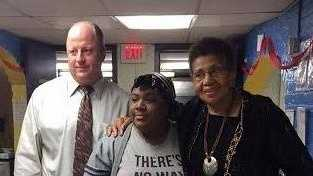 Goddard Alternative School Principal John Lander with Precious Barton, 19, who received a scholarship in memory of Carl Yancey, a former Goddard worker who was killed in a pedestrian crash in September 2014. His mother, Darhl Ellis, is to the right.
