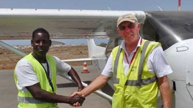 African Parks' pilot Bill Fitzpatrick (right) with an aviation official before departing from Dakar in Senegal on June 19, 2014 en route to the Republic of Congo. Fitzpatrick went missing en route between Nigeria and Cameroon.