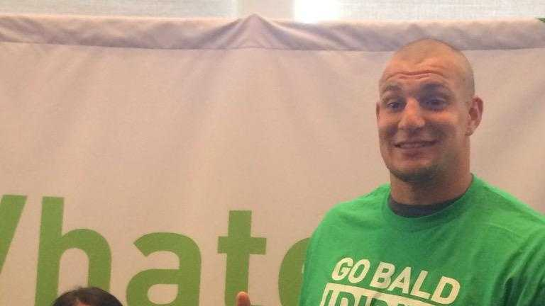 Gronk helps shave the heads of his brother, Gordie Gronkowski Jr., at Sunday's Buzz Off for Kids With Cancer.