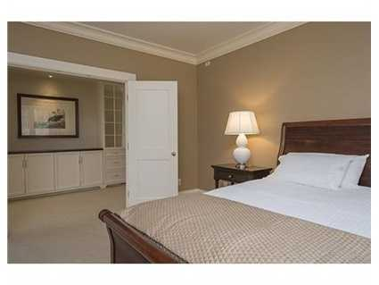 Tucked behind pocket doors is a stunning master suite with every luxurious detail one expects.