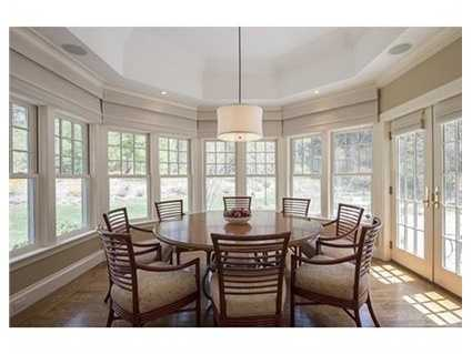An elegant formal dining room with a well appointed butler's pantry.