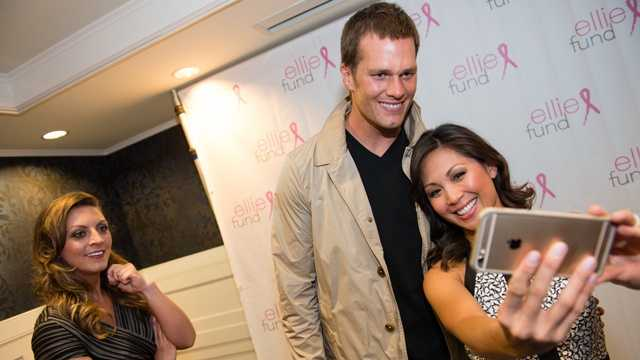 "NewsCenter 5's Antoinette Antonio takes a ""selfie"" with Tom Brady as Olessa Stepanova of NewsCenter 5's EyeOpener looks on."