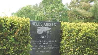 "BLOODY LEGACY: The Hells Angels' ""death's head"" insignia is engraved on top of a group headstone for gang members at Westview Cemetery in Lowell. ""AFFA stands for ""Angels Forever, Forever Angels."""