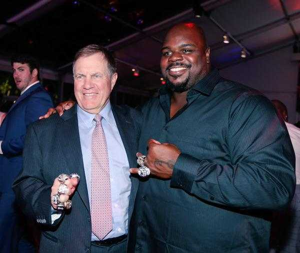 Coach Belichick with Vince Wilfork.