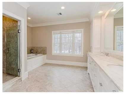 The large master bedroom ensuite has a double vanity, walk in closet and a sitting room/office.