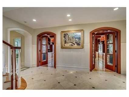 Sumptuous millwork, red birch and limestone flooring.