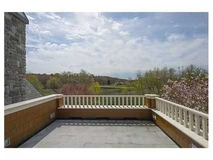 Pavered driveway leads to Courtyard and 82' stone Veranda surrounded by Magnolias, Japanese Maples, rose gardens with cobblestone walls and breathtaking views.