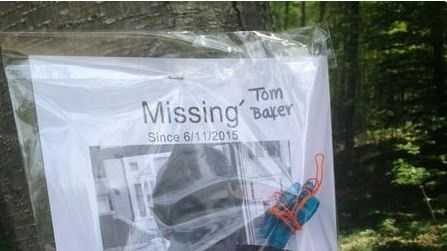 Missing posters and photos of Thomas Baker, who was found dead on Monday, were stapled to trees at the Blue Hills Reservation on Saturday with whistles and glow lights attached.
