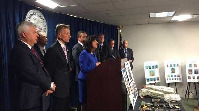 U.S. Attorney Carmen Ortiz speaks at a press conference along with FBI, Boston police and drug enforcement administration authorities, Thursday, June 18, 2015.
