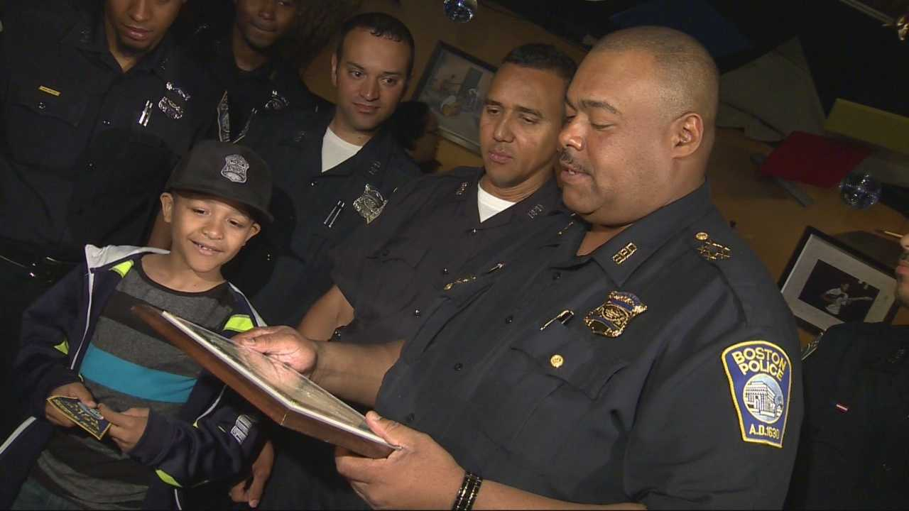A 7-year-old boy who was shot while riding his bike in Dorchester in May was named a junior police officer by the Boston Police Department on Sunday.