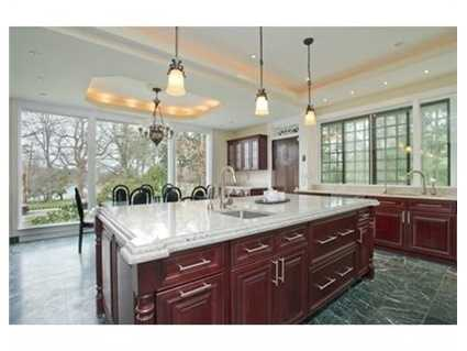 Gourmet kitchen with premium appliances and wine refrigerators.