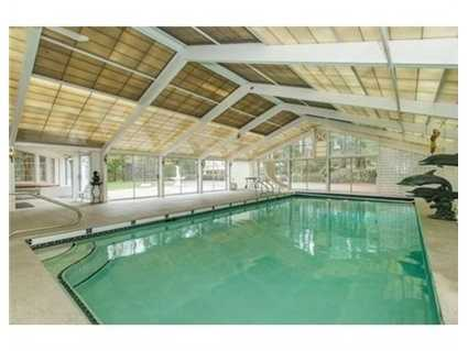 Hard to find indoor pool and outside tennis court.