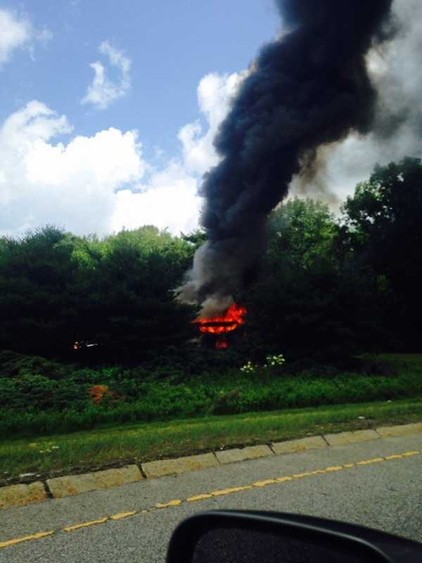 A bus fire has shut down the ramp the Mass. Pike to I-495 north on Monday.