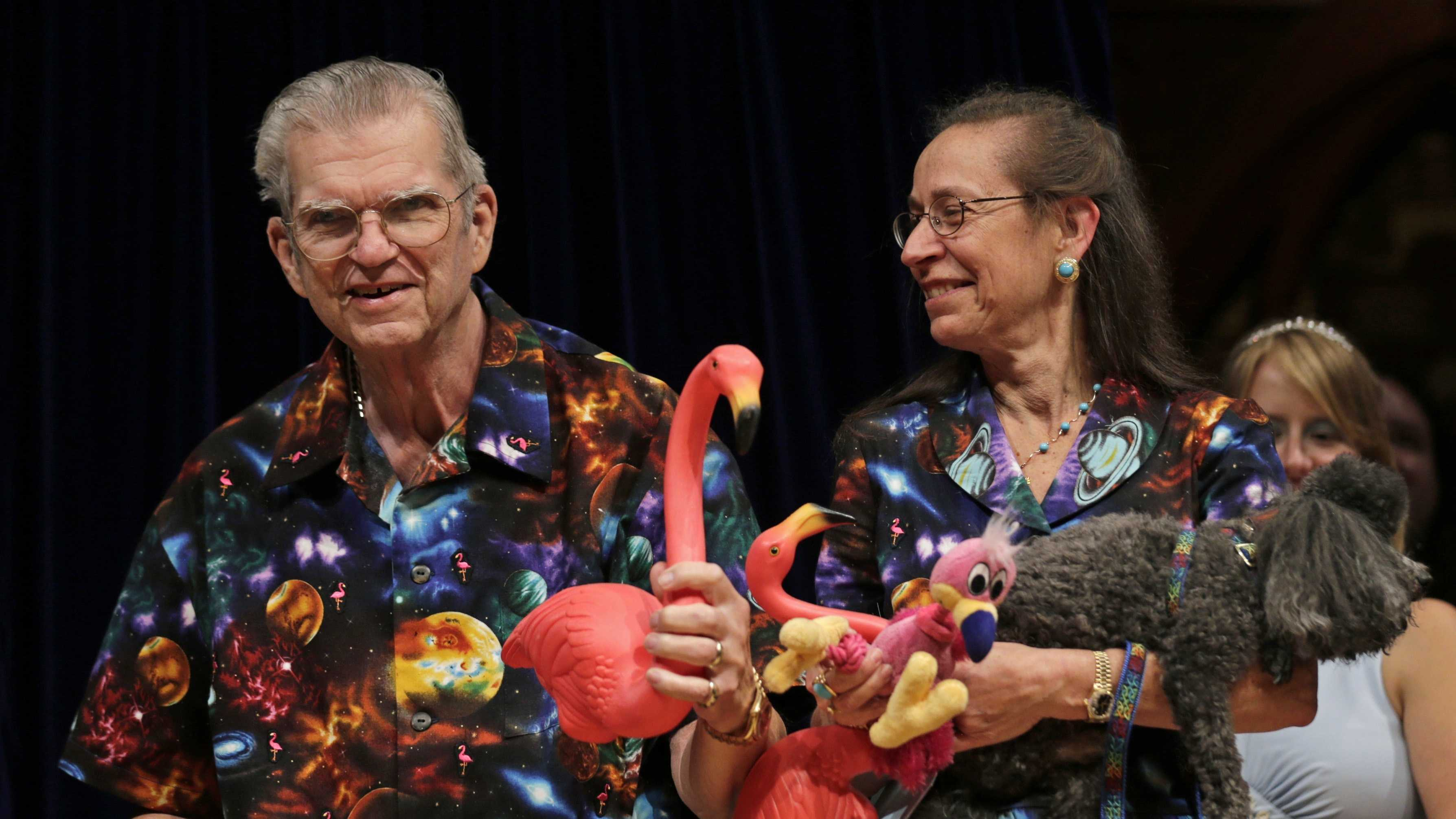 Artist Don Featherstone, 1996 Ig Nobel Prize winner and creator of the plastic pink flamingo lawn ornament, poses with his Nancy while being honored as a past recipient during a performance at the Ig Nobel Prize ceremony at Harvard University, in Cambridge, Mass., Thursday, Sept. 20, 2012.