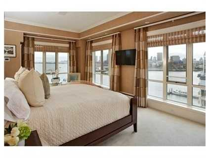 Master BR Suite with palatial master bath/spa with Boffi bath tub and sinks, radiant heated floor and fireplace