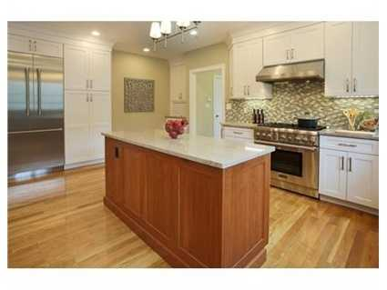 Budding chefs will delight in the gourmet kitchen complete with energy efficient Thermador appliances, island, breakfast bar, dining area with deck doors, gas and stone wall fireplace, and adjacent family room.