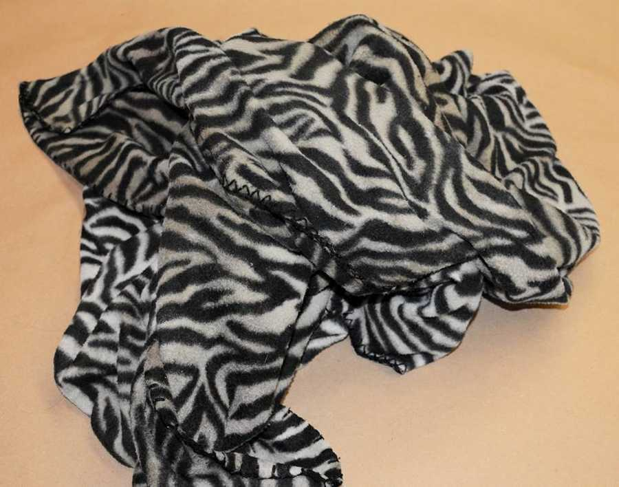 The girl, about 4-years-old, was wrapped in this zebra-print fleece blanket. It is manufactured by Cannon. It is a brand carried at KMart