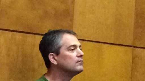 Michael R. Cook awaiting his arraignment in Framingham District Court on Monday.