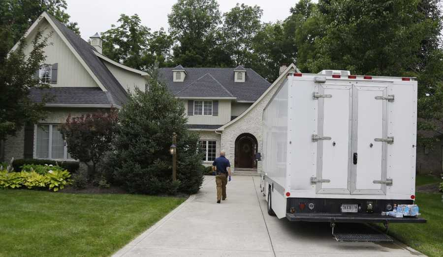 Federal authorities walk into the home of Subway restaurant spokesman Jared Fogle, Tuesday, July 7, 2015, in Zionsville, Ind. FBI agents and Indiana State Police have removed electronics from the property.