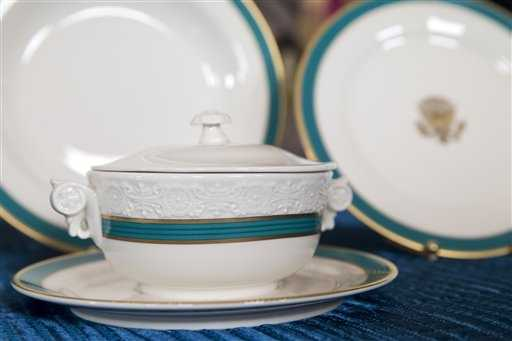 "An individual tureen that can be used for soup or dessert, part of the new Obama state china service, feature a fluted band of ""Kailua Blue"" framed by a textured gold rim."