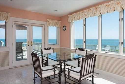 The open formal dining room offers expansive ocean views, exceptional great room with fireplace, spacious family room with fireplace, full wet bar, and slider to deck.