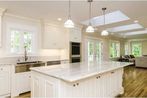 Breathtaking Chefs kitchen with large marble island, custom Omega cabinetry, Wolf stove, Sub Zero refrigerator, under counter wine refrigerator and hook ups in place for optional second dishwasher.