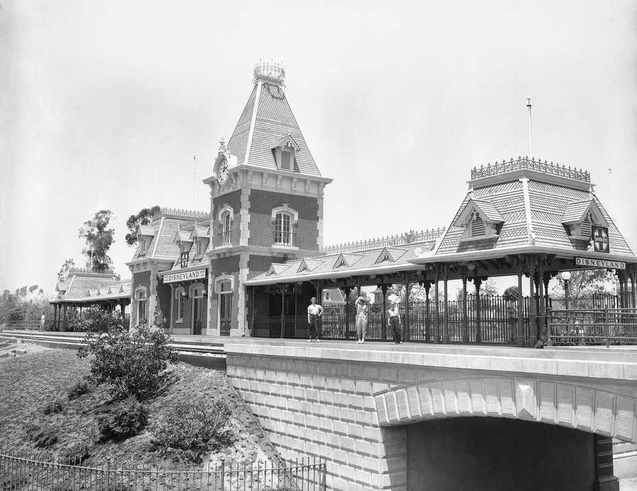Railroad station at entrance to Disneyland in California complete with bell tower, June 7, 1955. Visitors entering Disneyland will enter under tunnels at either side of the station. The Disneyland Railroad will take passengers all around the park. It is all built to the 1890 period.