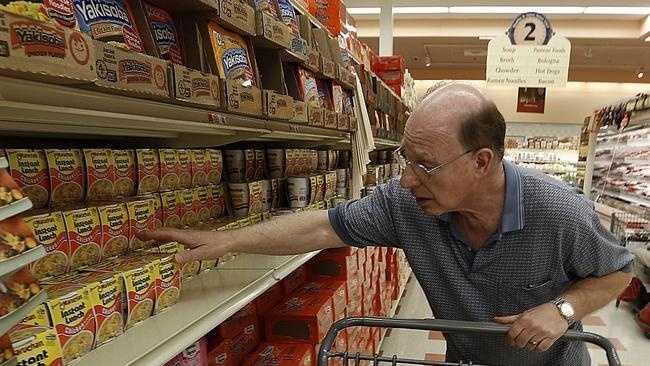 Bob Isveck, of Stoughton, grabs some Ramon noodles at the Brockton Market Basket on Sunday.