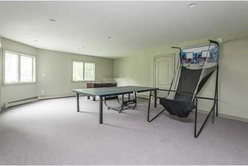 The walk out lower level boasts a playroom, additional bedroom/den and full bathroom and wine cellar.
