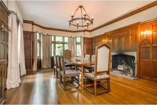 A banquet sized dining room w/laid linen paneling