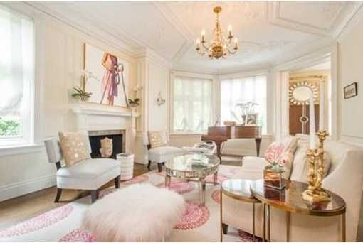 Elegant fireplaced living room adorned w/a unique plaster molded ceiling decorated w/musical instruments